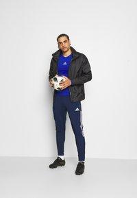 adidas Performance - TIRO 21 - Spodnie treningowe - team navy blue - 1