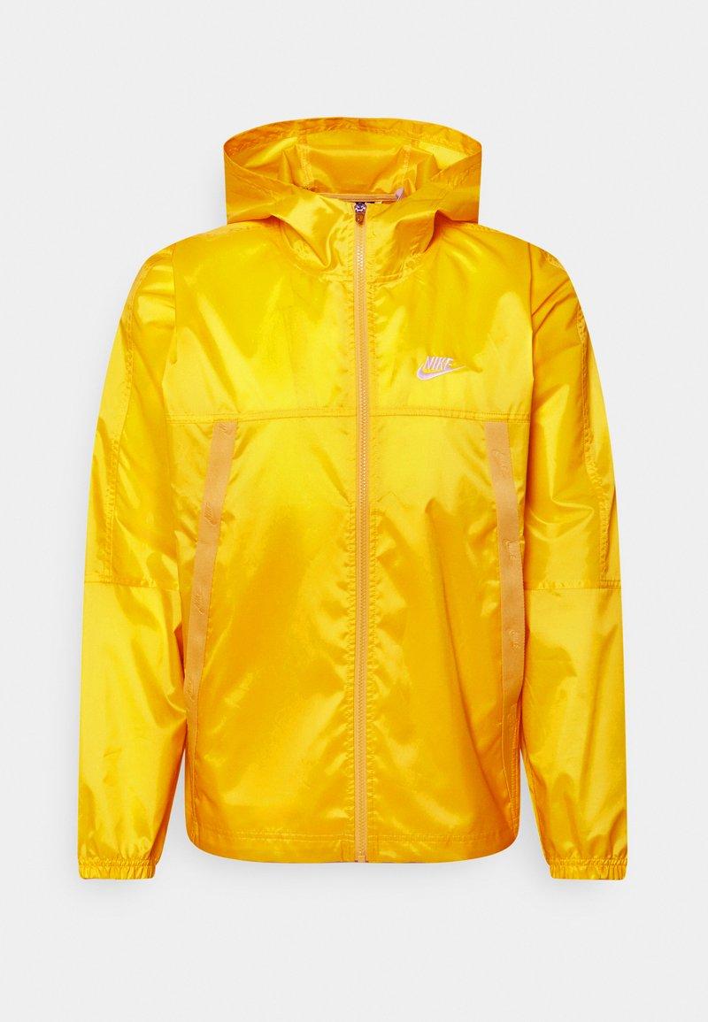 Nike Sportswear - REVIVAL - Kevyt takki - solar flare/sail
