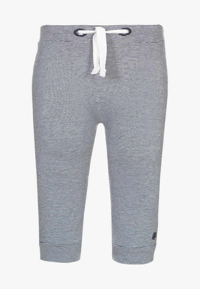 YIP - Tracksuit bottoms - light blue
