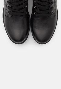 Jana - Platform ankle boots - black - 5