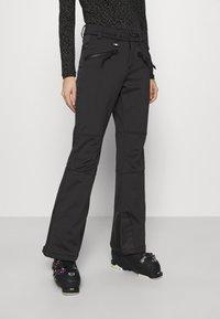 Superdry - SLALOM SLIM - Zimní kalhoty - black - 0