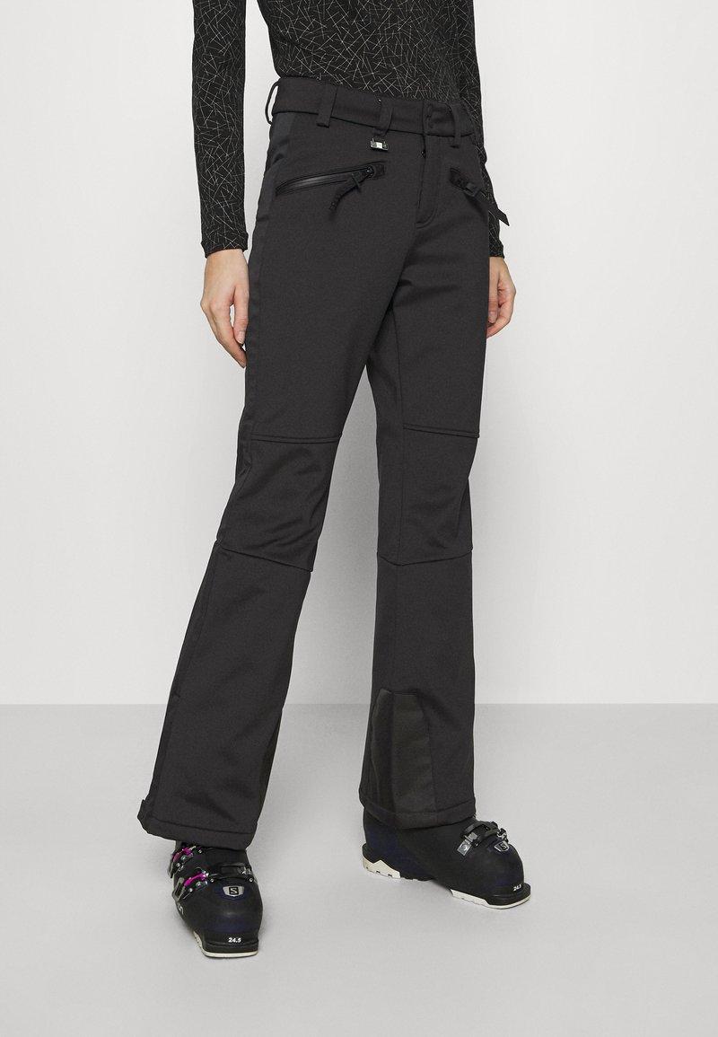 Superdry - SLALOM SLIM - Zimní kalhoty - black