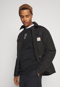 Carhartt WIP - GORE TEX MICHIGAN COAT - Light jacket - black - 3