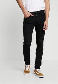 Levi's® - 519™ EXTREME SKINNY FIT - Jeans Skinny Fit - black denim - 0