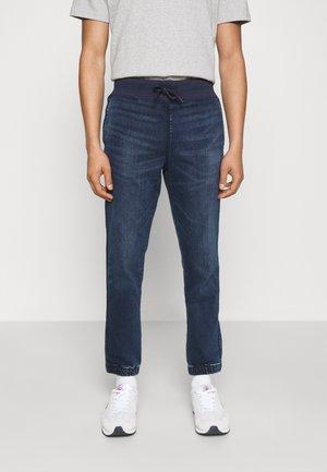 JOGGER  - Slim fit jeans - indigo wash