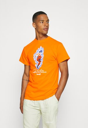 INSTINCT TEE - Print T-shirt - orange