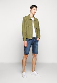 7 for all mankind - REGULAR HEMET - Denim shorts - mid blue - 1