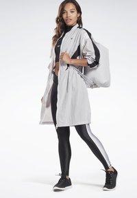 Reebok - STUDIO HIGH INTENSITY JACKET - Short coat - sterling grey - 1