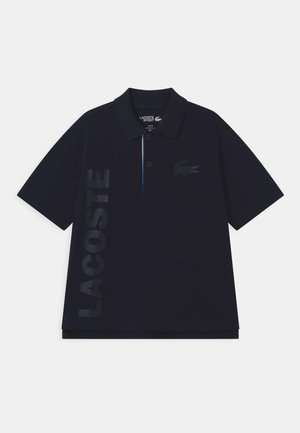 UNISEX - Polo shirt - navy blue