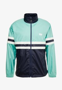 Levi's® - COLORBLOCKED WINDBREAKER - Summer jacket - night blue/crème/menthe - 4