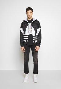 adidas Originals - BIG TREFOIL  - Windbreaker - black - 1