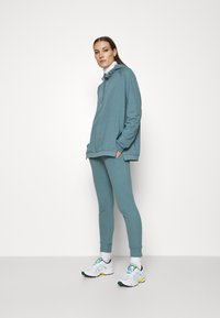 CALANDO - Tracksuit bottoms - turquoise - 1