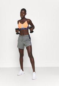 Nike Performance - INDY PRO BRA - Light support sports bra - bright mango/white/midnight navy/metallic silver - 1