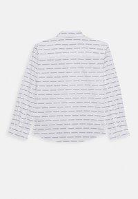 Calvin Klein Jeans - LOGO ALL OVER - Shirt - white - 1