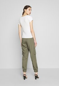 Abercrombie & Fitch - JOGGER - Trousers - green - 2