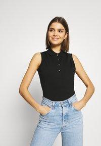 Lacoste - SLEEVELESS BASIC SLIM FIT - Poloshirt - black - 0