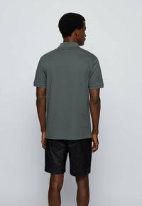 BOSS - KURZARM - Polo shirt - dark green - 2