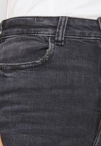 American Eagle - HIGHEST RISE JEGGING - Jeggings - black in the dayz - 4
