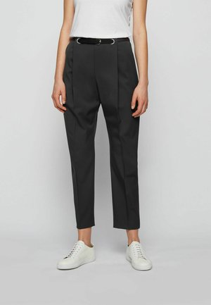 TAWAKEA - Trousers - black