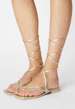 HAVEN - T-bar sandals - gold