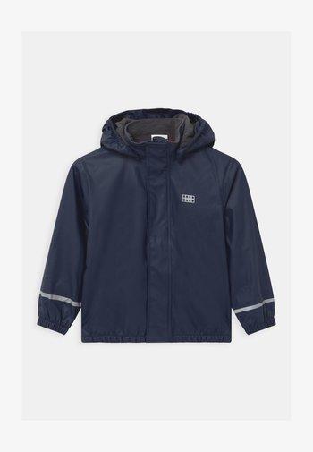 JIPE UNISEX - Waterproof jacket - dark navy