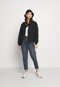 Carhartt WIP - KEYSTONE REVERSIBLE JACKET - Winter jacket - black - 1