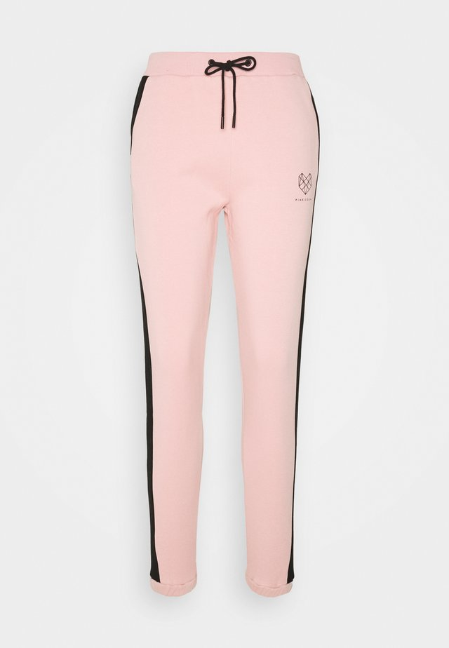 YARROW - Tracksuit bottoms - pink/black