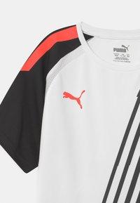 Puma - TEAM LIGA GRAPHIC JR UNISEX - Print T-shirt - puma whit/red blast/puma black - 2