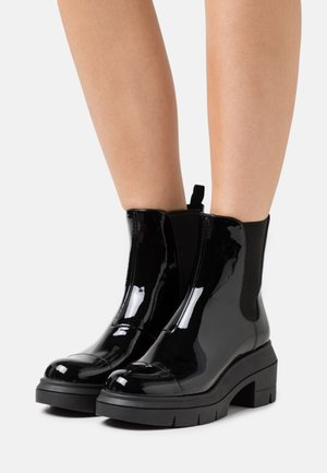 NORAH - Platform ankle boots - black
