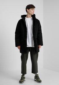Carhartt WIP - TROPPER - Winter coat - black - 1