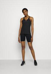 Nike Performance - FEMME ELASTIKA TANK - Toppe - black/metallic gold - 1