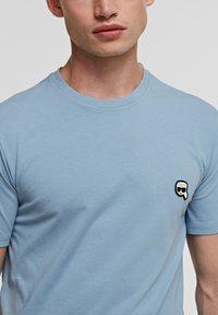 KARL LAGERFELD - IKONIK - Basic T-shirt - light blue - 3