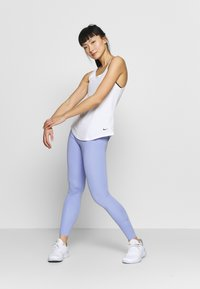 Nike Performance - DRY VICTORY ELASTIKA TANK - Sportshirt - white/black - 1