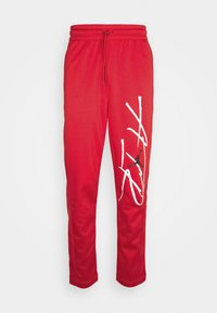 AIR THERMA PANT - Tracksuit bottoms - gym red/black