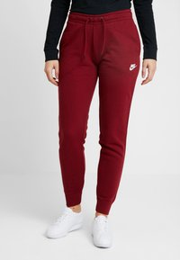 Nike Sportswear - Tracksuit bottoms - team red/white - 0