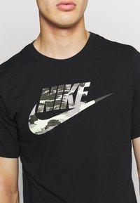 Nike Sportswear - TREND SPIKE - Camiseta estampada - black - 5