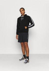 Champion - HOODED  - Sweatshirt - black - 1
