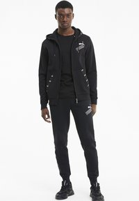 Puma - Zip-up hoodie - black - 1