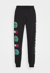 Tommy Jeans - LUV THE WORLD UNISEX - Tracksuit bottoms - black - 5