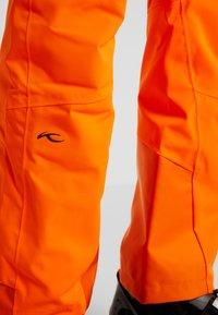 Kjus - MEN FORMULA PANTS - Snow pants - orange - 3