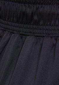 Bershka - Tracksuit bottoms - black - 5
