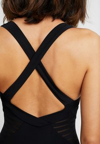 JETS Australia - LOW BACK INFINITY - Swimsuit - black