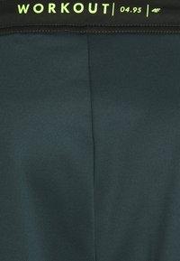 4F - Men's training pants - Tracksuit bottoms - green - 5