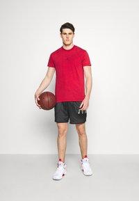 Jordan - DRY AIR - Basic T-shirt - gym red/black - 1