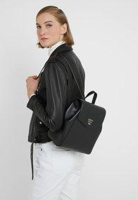 DKNY - WHITNEY FLAP BACKPACK - Plecak - black gold - 1
