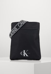 Calvin Klein Jeans - FLATPACK - Across body bag - black - 0