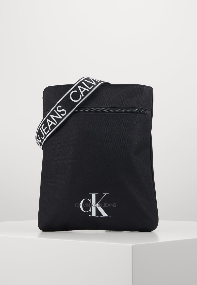 Calvin Klein Jeans - FLATPACK - Across body bag - black