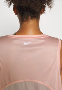 Nike Performance - MILER TANK PLUS - Sports shirt - washed coral/reflective silver - 5