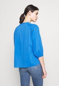 CLOSED - CHERRY - Button-down blouse - bluebird - 2