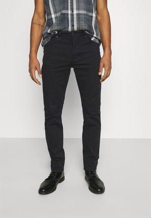 RAY STRAIGHT - Straight leg jeans - black